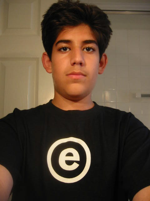 A photo of Aaron Swartz wearing his FREE MICKEY shirt.