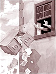 A file cabinet being thrown out the window